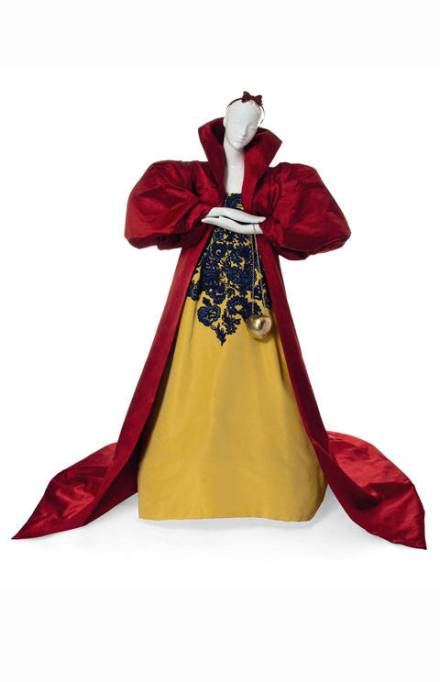 SNOW WHITE, AN OSCAR DE LA RENTA YELLOW SILK GOWN AND SCARLET SILK CAPE